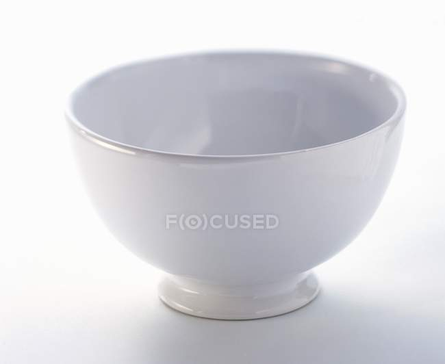 Closeup view of one white bowl on white surface — Stock Photo