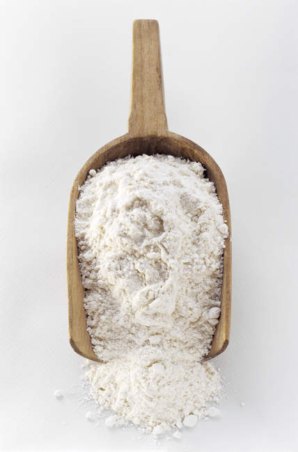 Wooden Scoop Filled with Flour — Stock Photo