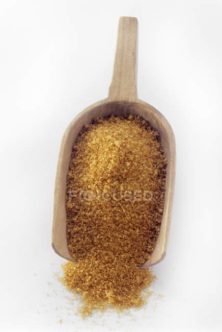 Brown Sugar in Wooden Scoop — Stock Photo