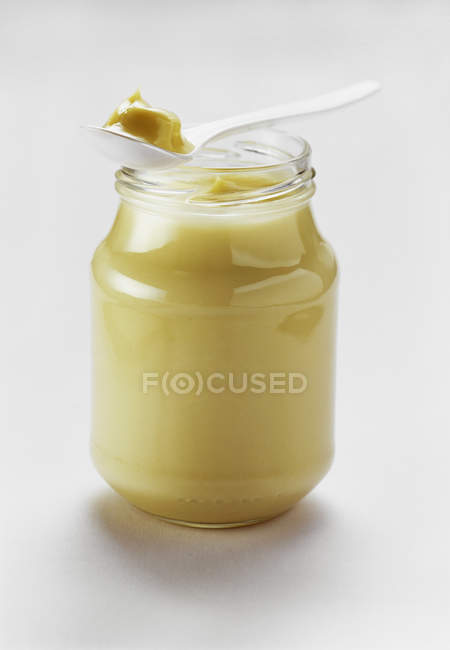 Jar of Mayonnaise with Spoonful — Stock Photo