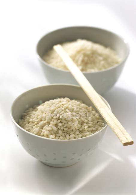 Rice in bowls and Chopsticks — Stock Photo
