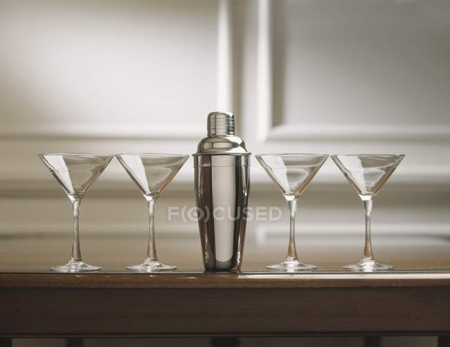 Four Martini Glasses with Cocktail Shaker — Stock Photo