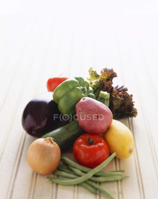 Fresh Vegetable Still Life on white wooden surface — Stock Photo