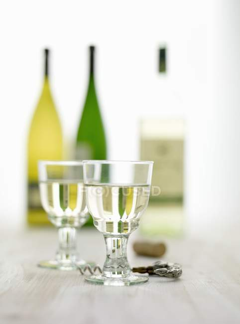 Glasses of  wine and bottles — Stock Photo