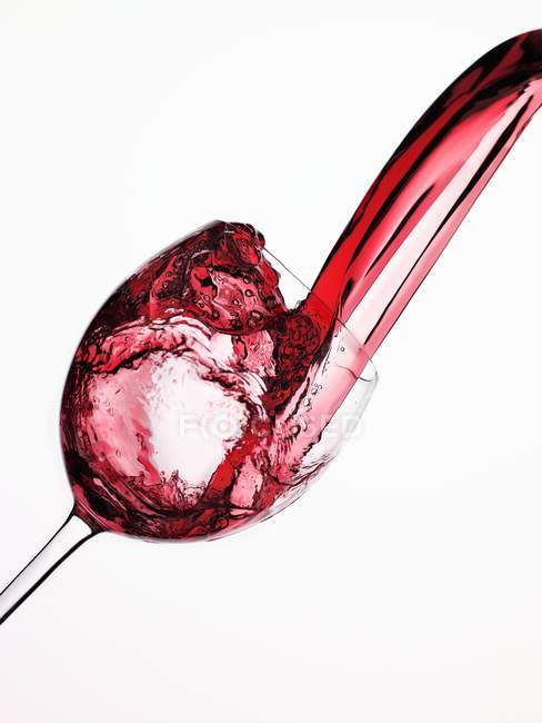 Red Wine Pouring into a Glass — Stock Photo