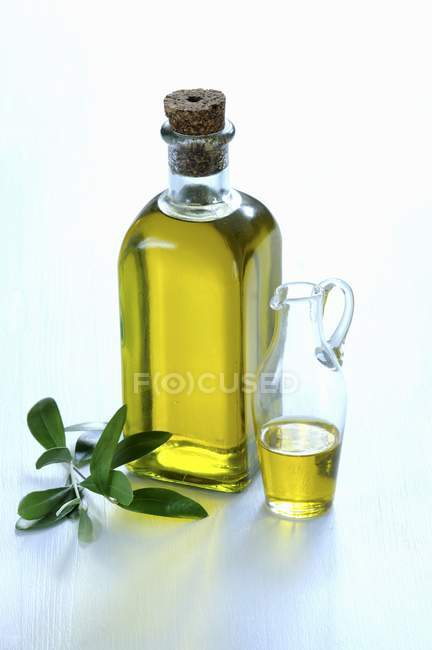 Bottle of olive oil with — Stock Photo