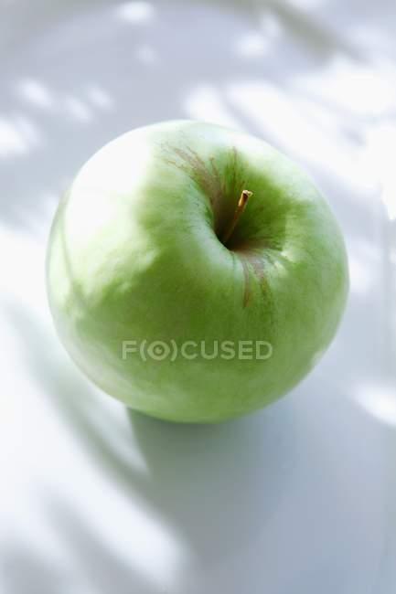 Green apple In sunlight — Stock Photo