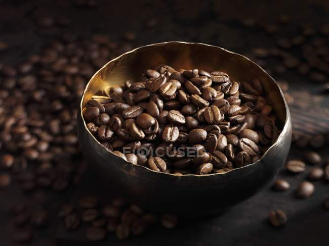 Coffee beans in bowl — Stock Photo