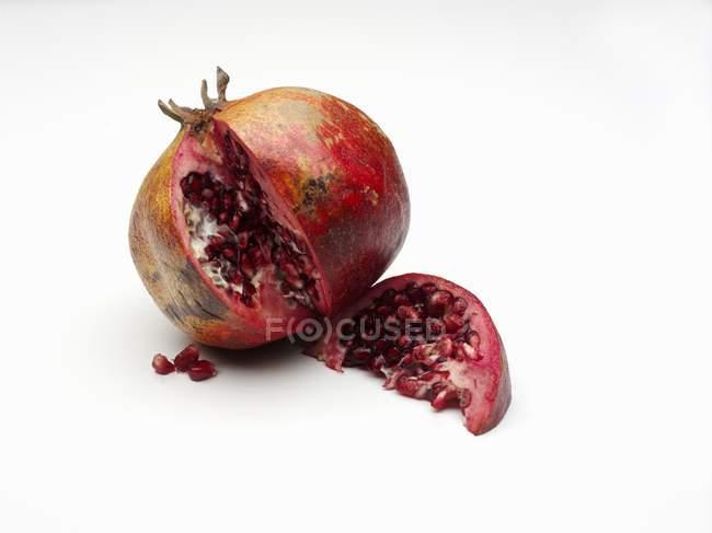 Tasty sliced pomegranate — Stock Photo