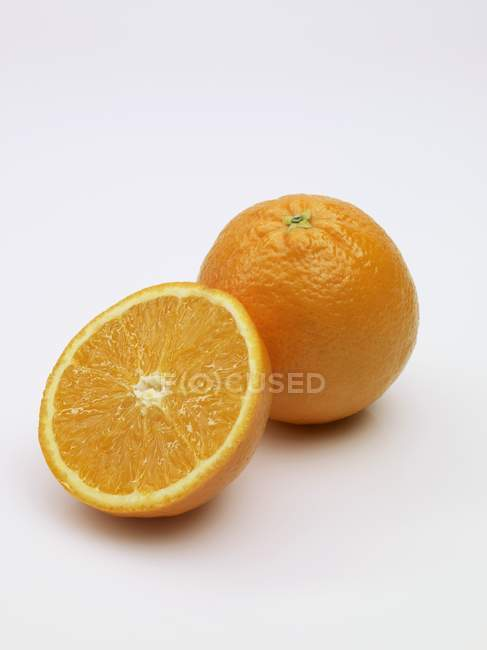 Fresh orange and half — Stock Photo