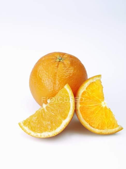 Fresh orange with slices — Stock Photo
