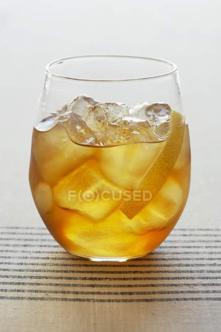Cocktail with Ice and Lemon Peel — Stock Photo