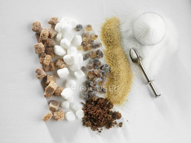 Closeup top view of vintage spoon with various types of sugar — Stock Photo