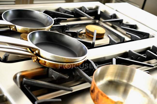 Closeup view of various pots on a gas cooker — Stock Photo