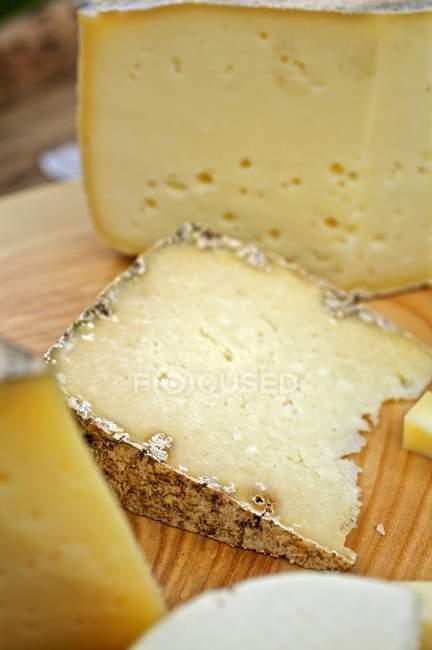Various chunks of cheese — Stock Photo