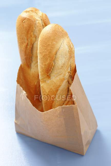 Baguettes in paper bag — Stock Photo