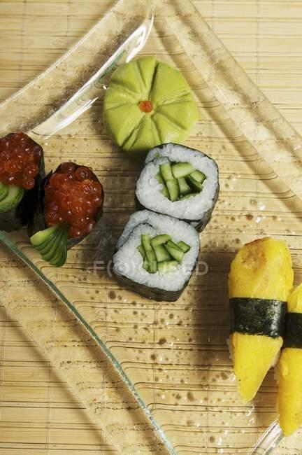 Maki sushi with cucumber and caviar — Stock Photo