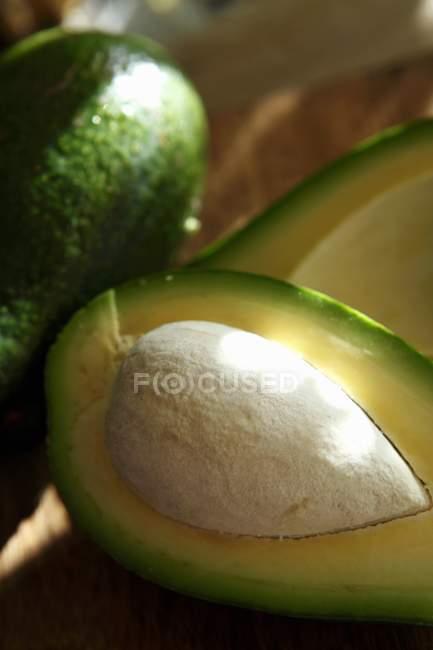 Fresh halved avocado — Stock Photo