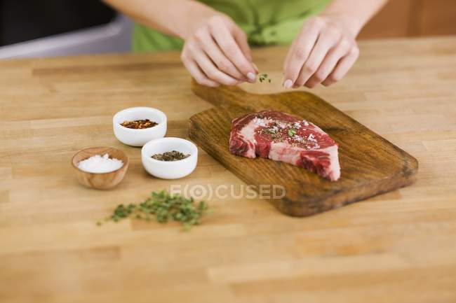 Woman Seasoning Steak — Stock Photo