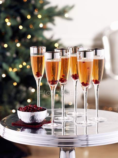 Rose champagne with pomegranate seeds — Stock Photo