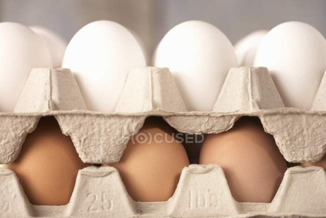 Brown and white eggs — Stock Photo