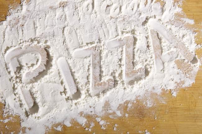 Palavra escrita em farinha — Fotografia de Stock
