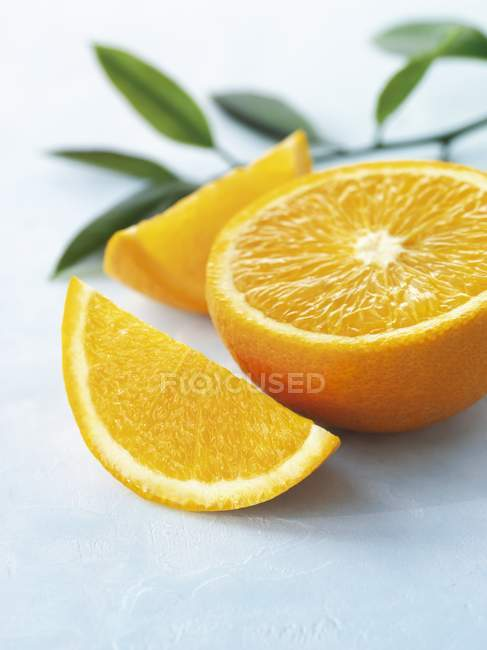 Fresh orange and slices — Stock Photo