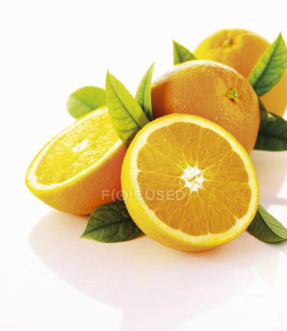 Fresh ripe oranges with leaves — Stock Photo