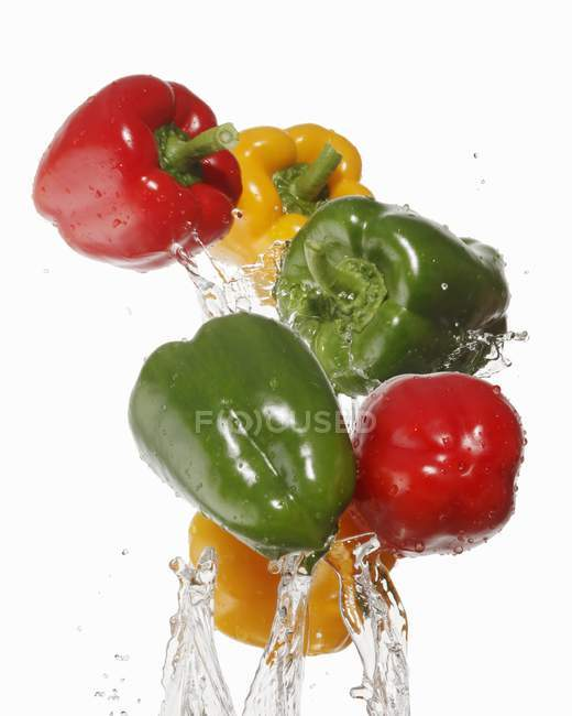 Bell peppers with splash of water — Stock Photo