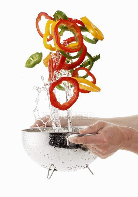 Hands washing Pepper rings — Stock Photo