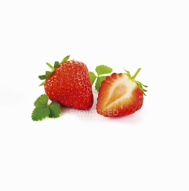 Whole strawberry and half strawberry — Stock Photo