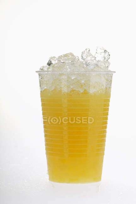 Orange juice in plastic tumbler — Stock Photo
