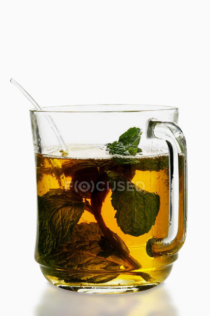 Peppermint tea in cup — Stock Photo