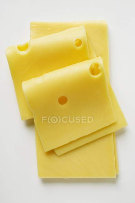 Emmental cheese in slices — Stock Photo