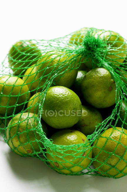 Key limes in net — Stock Photo