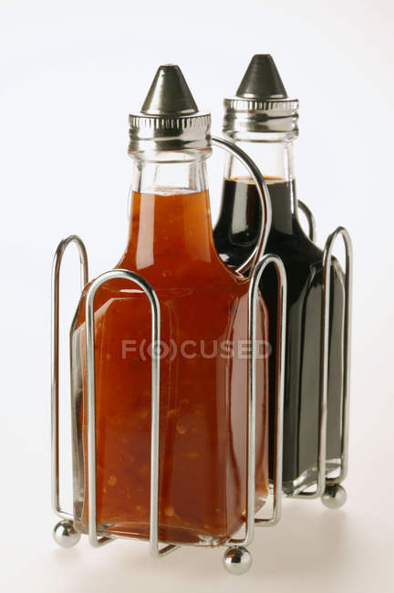 Chili sauce and soy sauce in bottles — Stock Photo
