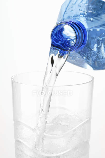Pouring mineral water — Stock Photo