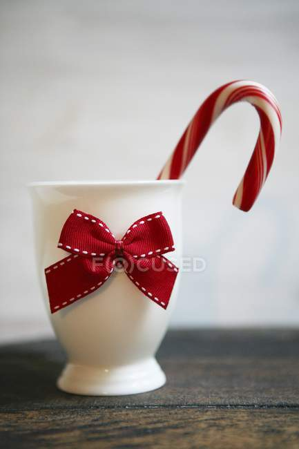 Cane in porcelain cup — Stock Photo