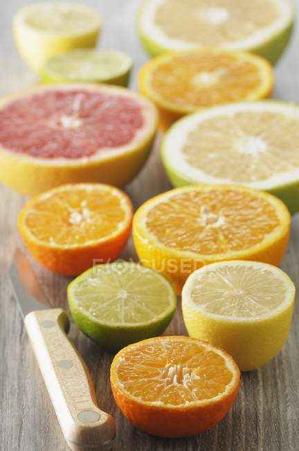 Assorted halved citrus fruits — Stock Photo