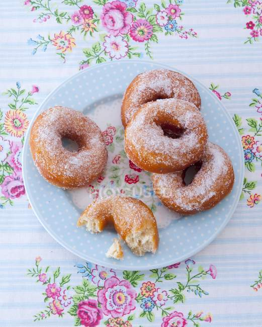 Sugared doughnuts on plate — Stock Photo