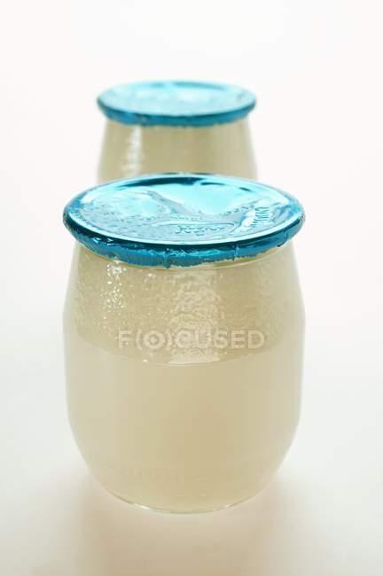 Two jars of yoghurt — Stock Photo