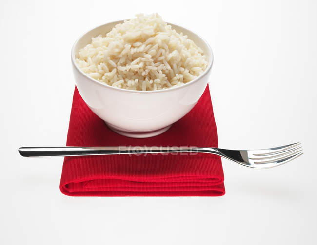 Bowl of long rice and fork — Stock Photo