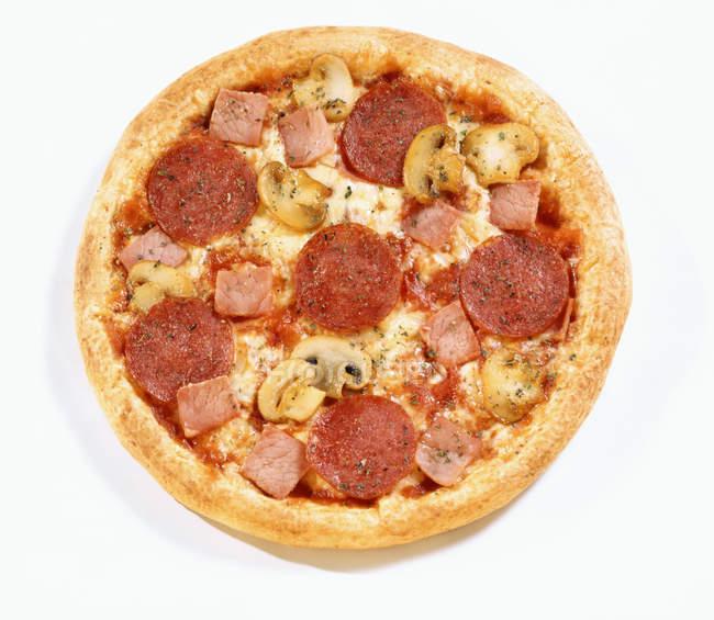 Pizza with salami, ham and mushrooms — Stock Photo