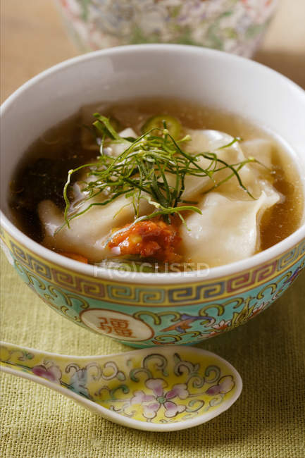 Broth with wontons and strips — Stock Photo