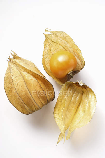 Physalis fruits with and without calyx — Stock Photo