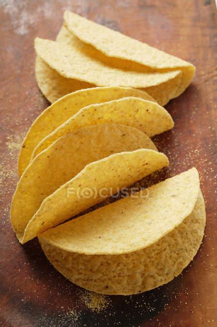 Tacos de madeira mesa — Fotografia de Stock