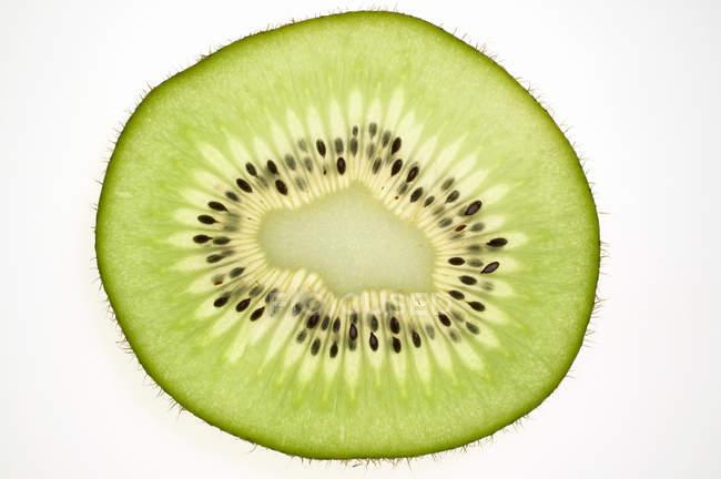 Rebanada de fruta de kiwi - foto de stock