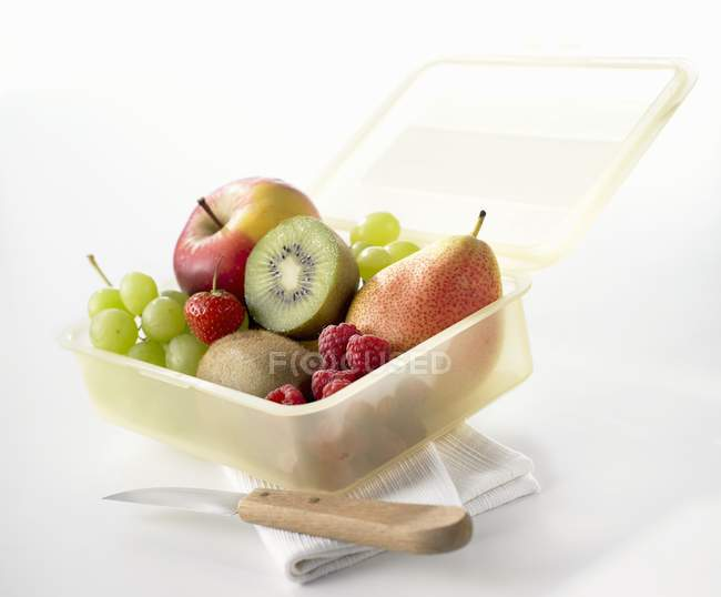Lunch box with fresh fruits — Stock Photo