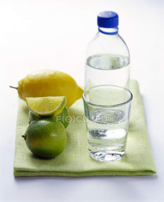 Bottle and glass of mineral water — Stock Photo