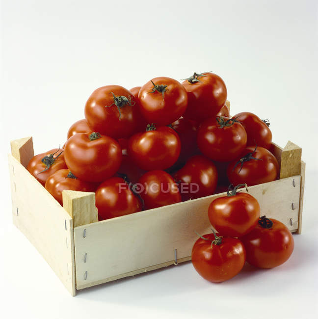 Tomatoes in wooden box — Stock Photo